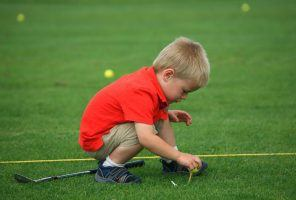 little-boy-on-golf-course