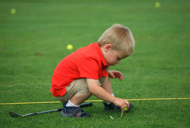 little-boy-on-golf-course