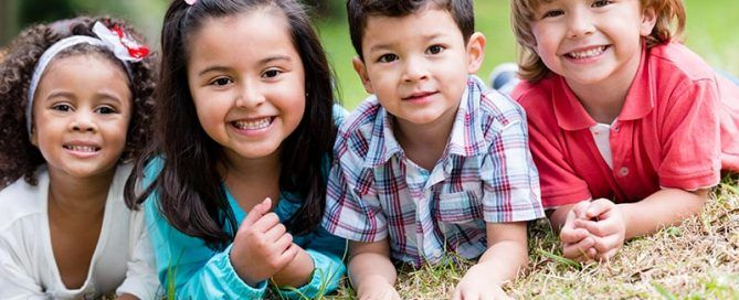 Smiling children in the grass