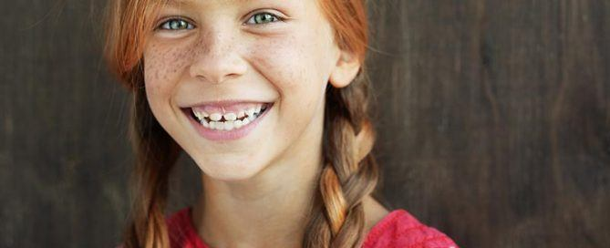 Smiling redhead with pigtails