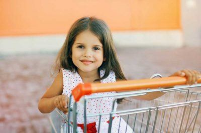 Girl in Shopping Cart